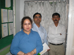 A visiting UK delegate team with director